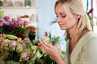 Woman choosing flowers in a florist´s shop