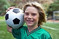 Portrait of boy soccer player with ball