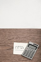 Adhesive note and calculator
