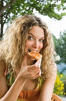 Young woman eating toast