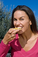 Woman eating bruschetta