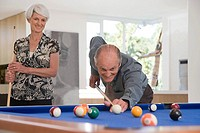 A senior couple playing pool (thumbnail)