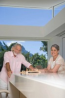 A senior couple playing chess