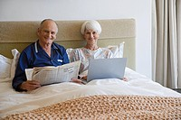 A senior couple in bed