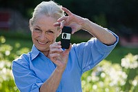 Woman using camera telephone