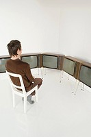Man watching televisions