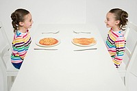 Twins having different spaghetti
