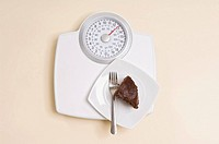 Chocolate cake on weight scales