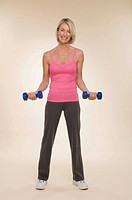 A woman lifting dumbbells