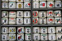 Painted sake barrels as sacrificial offering at shinto shrine, Kamakura, Japan