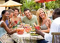 Multi_ethnic couples eating outdoors