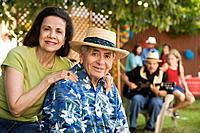 Senior Hispanic couple at outdoor party