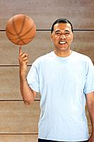 African man spinning basketball on finger