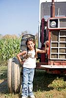 Hispanic girl next to tractor