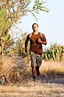 Hispanic man jogging with backpack