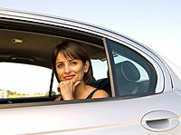 Indian woman sitting in backseat of car