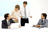 Business executives working together in office