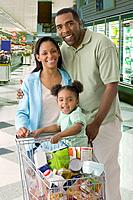 Mixed Race family shopping in grocery store