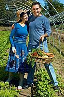 Multi_ethnic couple with basket of organic produce