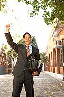 Asian businessman cheering