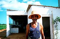 Farmer in front of farm house near Cardenas, Cuba