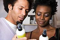 Multi_ethnic couple looking at hair product