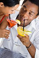 Multi_ethnic couple drinking cocktails