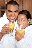 African couple drinking orange juice