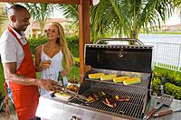 Multi_ethnic couple barbecuing