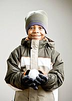 Mixed Race boy holding snowball