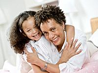 African mother and daughter hugging