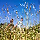 Multi_ethnic couple walking in tall grass