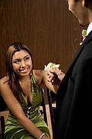 Hispanic teenaged girl smiling at boyfriend