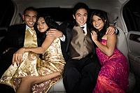 Multi_ethnic couples hugging in limousine