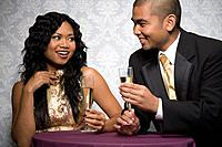Multi_ethnic couple drinking champagne