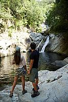 Hispanic couple looking at waterfall