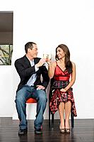 Multi_ethnic couple toasting with champagne