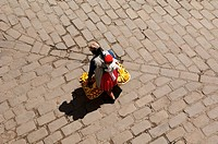 Ecuador - Azuay Province - Cuenca. Woman carries child and fruit