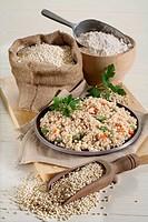 Still life - Barley. Pearl barley, barley grains, barley flour, basic pearl barley dish 'orzotto'