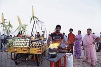 Corn seller on the beach, Marina beach, Chennai, Tamil Nadu, India