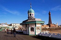 Four people standing near a candy shop, North Pier, Blackpool Tower, Blackpool, Lancashire, England
