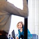 Businesswoman Using Telephone in Office