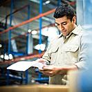 Warehouse Worker Looking at Paperwork