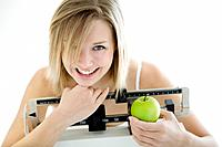 Woman Holding Apple on Scale
