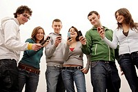 teenagers with mobile phones