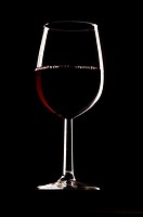Close_up of a glass of red wine
