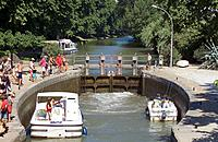 "Pleasure boats in lock ""Canal du Midi"", Languedoc, France."