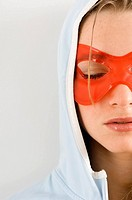 Close_up of a young woman wearing an eye mask