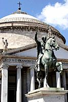 The equestrian bronze statue of Charles III of Borbone in front of Church of San Francesco di Paola on the Piazza del Plebiscito. Naples. Campania. It...