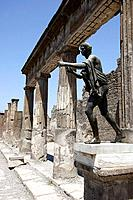 The statue of Apollo in the ruins of Temple of Apollo. Pompei. Campania. Italy